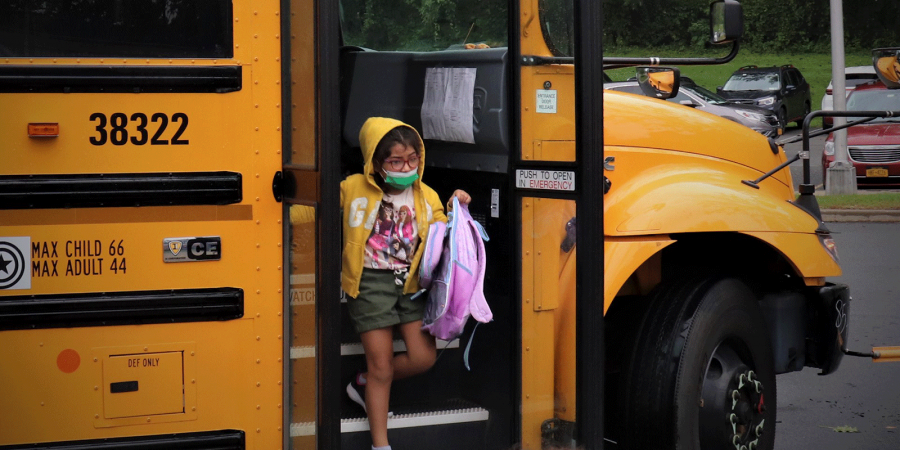 Student descending bus